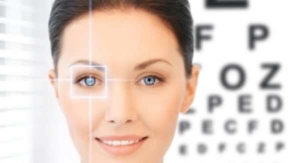 Woman in front of an eye chart