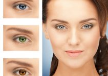 Woman with examples of colored contact lenses